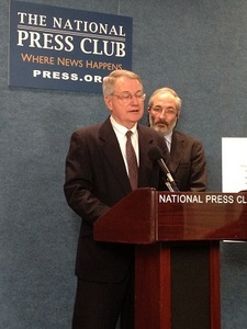 CFA Executive Director Stephen Brobeck addresses the press conference at the National Press Club. CUNA Economist Bill Hampel is in the background.