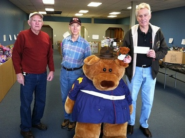 From left, Irving Morley, Nolan LePage and Bruce Aldrich are all helping to run the Toys for Tots Drive in Swansea, Mass.