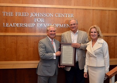 From left, Fred Johnson, retiring CUES president/CEO; Jeff Post, president/CEO of CUNA Mutual Group; and Teresa Freeborn, CUES board