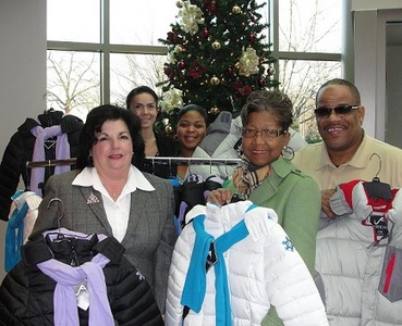 Gathered at the coat pickup at the credit union are, from left, Veronica Cowley, SJFCU loan officer; Veronica Ortiz, SJFCU Deptford branch manager; Deanjra Smith, SJFCU member service representative; LaVerne Harvey, CEA president; and Robert Farmer, CEA first vice president.
