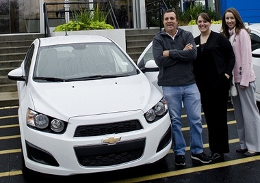From left, 2012 Chevy Sonic winner Ruben Lopez; Amy Etheridge, electronic marketing coordinator; Christol Clymer, marketing promotions coordinator.