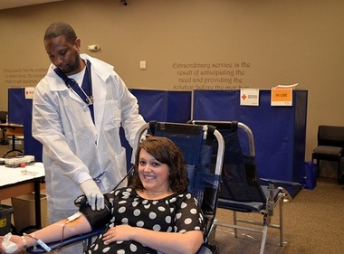 An American Red Cross staffer checks on Robins FCU employee Amy Etheridge as she donates blood during the big credit union's semiannual blood drive earlier this month.