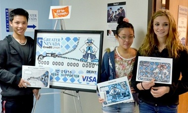Mhervin Dagdagan, Amanda Yau and Athena Favero stand by the new Carson High School debit card they helped design for Greater Nevada Credit Union.