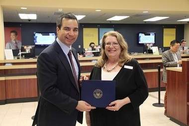 LJ Tarman (right), vice president of marketing and public relations for NuVision Federal Credit Union, with Sinan Kanatsiz, CEO of public relations and marketing firm KCOMM, after Tarman and NuVision received special recognition from the U.S. Congress for her leadership and community contributions.