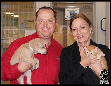 Steve Boylan, left, TDECU regional vice president, Houston Market, and Patti Mercer, president of the Houston SPCA.