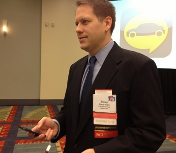CUNA Mutual Group's Steve Hoke demonstrates AskAuto mobile lending technology during a press briefing at CUNA's Governmental Affairs Conference on Monday morning.