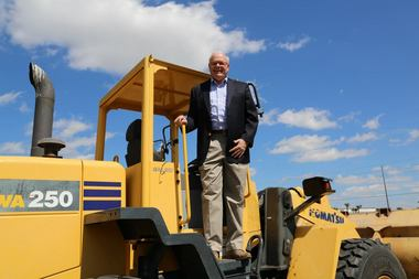 Here, the 156,500-member credit union's president/CEO, Bob Fisher, eschewed the golden shovel and instead posed with some heavier construction equipment at the groundbreaking, which was attended by the Wesley Chapel Chamber of Commerce.