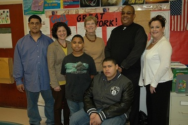 Back row, from left, Geraldo Texider, student at Little Flower UFSD; Lisa Boerum, assistant superintendant; Ann Romeo, assistant superintendant for business; George Grigg, superintendant of Little Flower UFSD; and Stacey Hogan, business development representative of Suffolk Federal Credit Union Front row, from left, students of Little Flower UFSD Gerald Ruffin and Justin Woods.