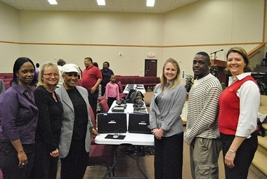 From left, Angie Johnson and Mary Kay Gutknecht, TDECU; Anna Pettus, Greater Mount Zion; Michel Azbell, TDECU; Kevin Garrett, Greater Mount Zion, and Anne Allstott, TDECU.