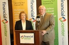 Horizon One President Ann Garmon and Financial Center President Kevin Ryan announce the two credit unions are merging. Here they are shown breaking the news at the Horizon One's branch in Greenwood, Ind.