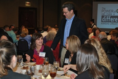 Kansas Gov. Sam Brownback works the tables at the annual KCUA gathering.