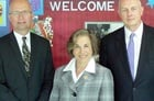 Rep. Jan Schakowsky meets with Alliant Senior Vice President Lee Schafer, left, and President/CEO David Mooney at their visit to Algonquin Middle School. Below, the lawmaker sits in on the class.
