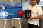 Alexis Acevedo, ABNB member and drawing winner, shows off his new iPad.